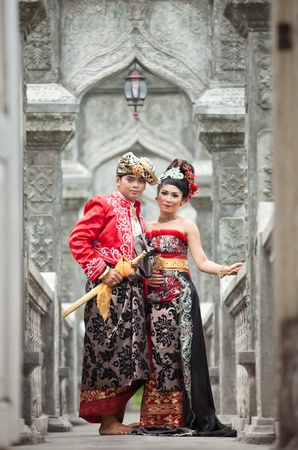 udeng: BALI - JANUARY 29. Performers enacting wedding scene in preparation for religious ceremony on January 29, 2012 in Bali, Indonesia. Most Balinese get married in their early 20s. Editorial