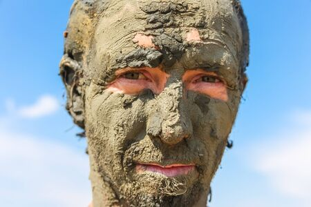 Man smeared with healing mud on beach Stock Photo - 17085491