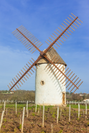 vendee: Old round traditional windmill with wooden propellers in countryside.
