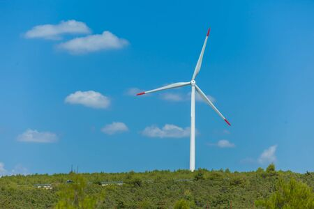 Windmill is a machine that is used to produce electricity. Stock Photo - 17260064