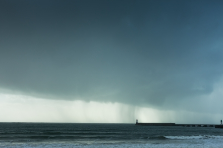 Stormy weather with rain clouds and lighthouse in the Sable dOlonne in France photo