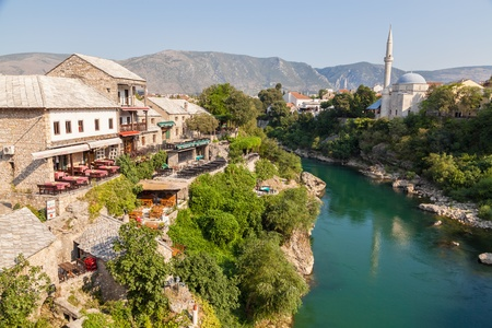 MOSTAR, BOSNIA -  View of old town from Stari Most bridge  in Mostar, Bosnia  This old town founded in 1452, was mostly destroyed during the Bosnian war from 1991 to 1995