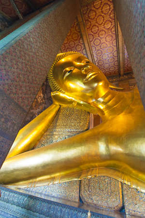 Reclining Buddha in Wat Pho temple in Bangkok, Thailand photo