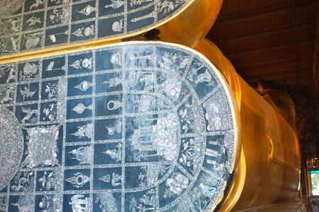 Reclining Buddha s feet in Wat Pho temple in Bangkok, Thailand photo