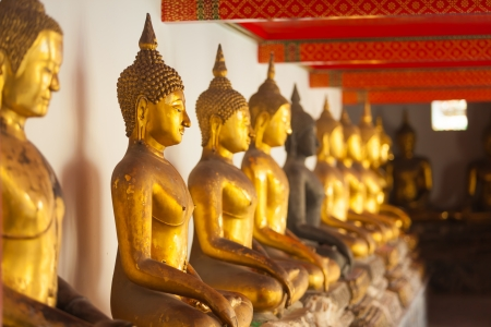 Buddha statues in the Wat Pho temple in Bangkok, Thailand photo