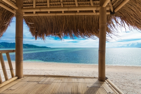 huts: Seaview from bamboo hut on beach on Gili Air island, off Bali in Indonesia Stock Photo