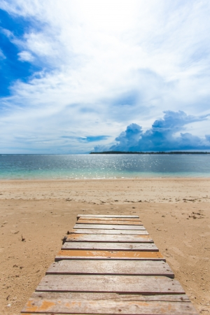 Wooden jetty on tropical beach on island Imagens