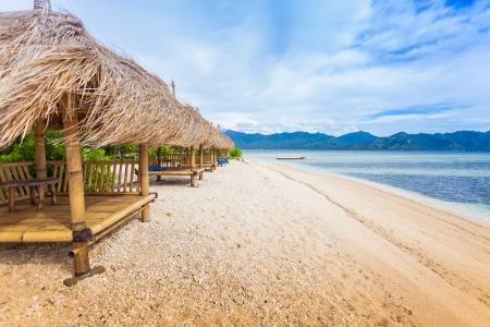 Bamboo hut on beach on sea photo