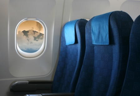 Airplane seat and window inside an aircraft with view on sea in Croatia  photo