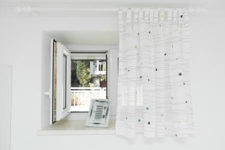 half open: Open window with white curtain half drawn