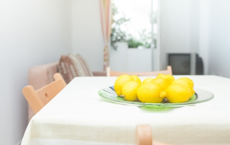 Modern and bright living room inter in house with lemons on table Stock Photo - 19119106