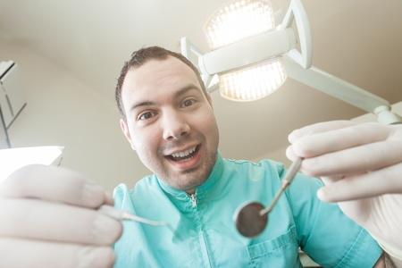 scaler: Dentist working with tools in practise