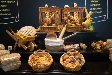 french bakery: Display of bread variety on shelves in interior