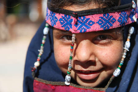 dahab: DAHAB, EGYPT - JANUARY 24, 2011: Egyptian girl posing on January 24, 2011 in Dahab, Egypt. She wears a a burqa with traditional ornaments.