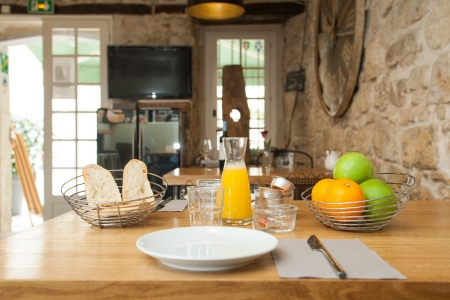 Breakfast served on the table of French bistro with rustic furniture. photo