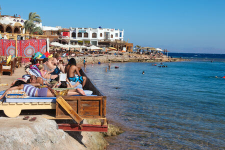 dahab: DAHAB - JANUARY 23. Tourists enjoying the Sinai coast in Dahab, Egypt. Dahab is a popular destination for diving holidays. Editorial