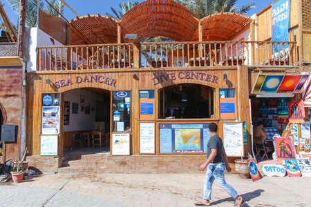 dahab: DAHAB, EGYPT - JANUARY 24, 2011: Man walking by the dive center on January 24, 2011 in Dahab, Egypt. Dahab has many diving centers because it is near the Blue Hole.