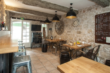 brasserie: Interior of French bistro with rustic furniture. Editorial