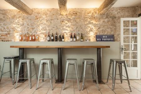 vence: VENCE, FRANCE - SEPTEMBER 16: Wine bottles on the shelve at Bed and Bistrot on 16 September, 2013 in Vence, France. Bed and Bistrot is a new concept hotel in Vence.