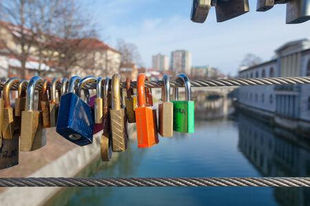 2 persons: LJUBLJANA, SLOVENIA - FEB 19: Love padlocks on the Butchers Bridge on February 19, 2013 in Ljubljana, Slovenia. Each padlock symbolises the love of 2 persons  whose names are usually written on the padlock itself.