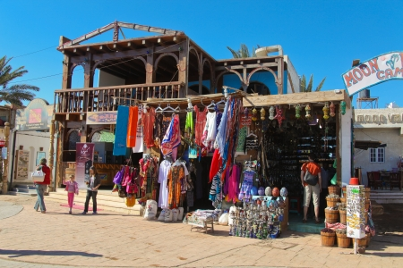 fled: DAHAB - JANUARY 23: Few tourists in handicraft shop on January 23, 2011 in Dahab, Egypt. Most tourists fled the touristic zones of the Sinai.