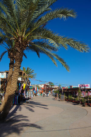 dahab: DAHAB - JANUARY 23. Walkway with shops and restaurants in Dahab, Egypt. Dahab is a popular destination for diving holidays.