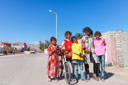 dahab: DAHAB, EGYPT - FEBRUARY 2, 2011: Children play on the road on February 2, 2011 in Dahab, Egypt. Theres no childrens playground and the kids play on the road.