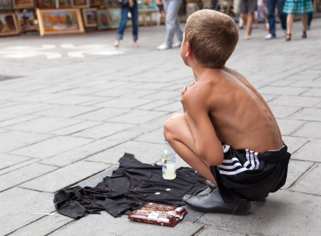 10 11 years: SARAJEVO, BOSNIA AND HERZEGOVINA - AUG 11: Sevdalija Osmanovic, 10 years old, sings on street to bypassers on August 11, 2012 in Sarajevo, B&H. He sings in order to provide money for his family.