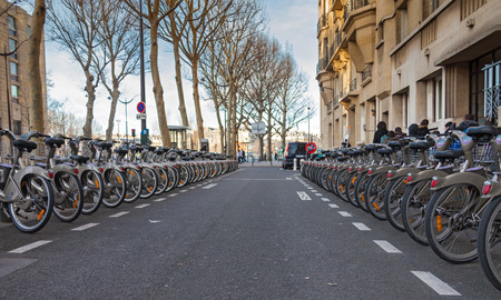 PARIS, FRANCE - JANUARY 6, 2012: Velib bicycles in the row. Velib is a large-scale public bicycle sharing system in Paris, France. Editorial