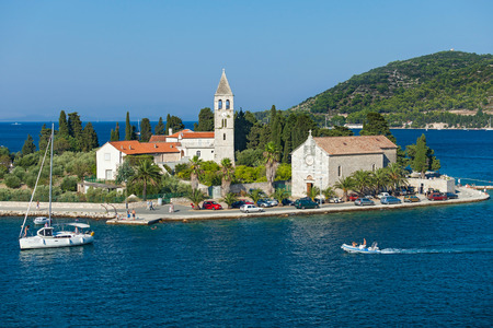 inhabited: VIS, CROATIA - AUGUST 19, 2012: St. Juraj church, the first sight which greets visitors to on arrival to Vis, the furthest Croatian inhabited island. Editorial