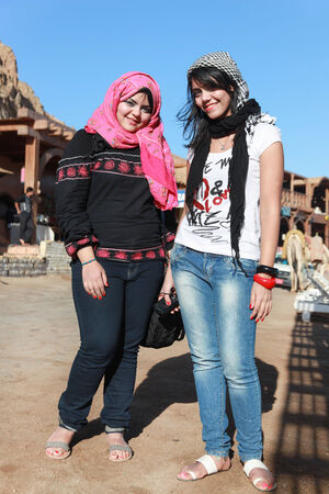 egyptian woman: DAHAB, EGYPT - JANUARY 30, 2011: Modern young Egyptian girls woman wearing hijab, traditional head cover or wrap worn by Muslim women. Editorial