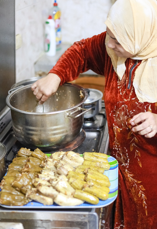 civilisations: DAHAB, EGYPT - FEBRUARY 2, 2011: Egyptian woman prepares traditional meal. Egyptian food is a mixture of all the different civilisations that came to Egypt in the history of its existence. Editorial