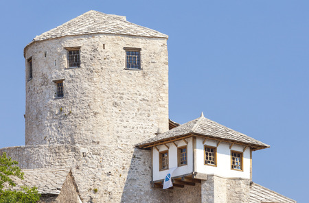 MOSTAR, BOSNIA AND HERZEGOVINA - AUGUST 10, 2012: Detail of the Old Bridge, UNESCO World Heritage Site.