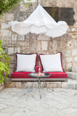 Outdoor seating on cushions in little cafe in Mostar, Bosnia   photo