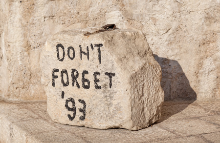 Closeup shot of 'Don't Forget' stone located near the Old Bridge in Mostar, Bosnia and Herzegovina.
