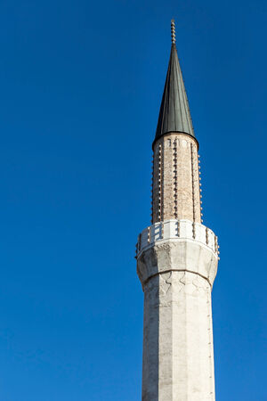 Mosque tower against the clear blue sky. photo