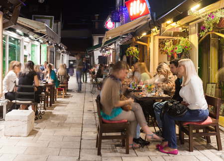 alfresco: SARAJEVO, BOSNIA AND HERZEGOVINA - AUGUST 13, 2012: Alfresco cafe and restaurants at night crowded with tourists and locals. Nightlife is vibrant during the summer months in Sarajevo old town.