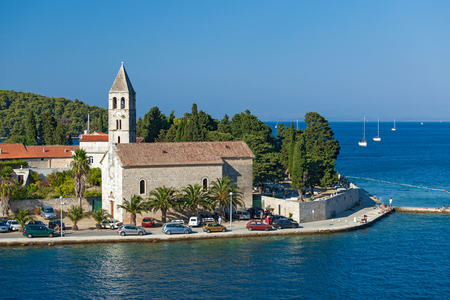 furthest: VIS - CROATIA: AUGUST 19, 2012: St. Juraj church, the first sight which greets visitors to on arrival to Vis, the furthest Croatian inhabited island.