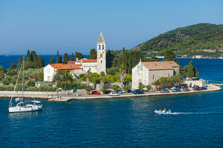 first sight: VIS - CROATIA: AUGUST 19, 2012: St. Juraj church, the first sight which greets visitors to on arrival to Vis, the furthest Croatian inhabited island.