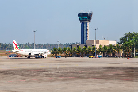 COLOMBO, SRI LANKA - FEBRUARY 19, 2014: Sri Lankan Airplane parked on apron in front of air traffic control tower at  Bandaranaike International Airport. It is hub of Sri Lankan Airlines, the national carrier of Sri Lanka.