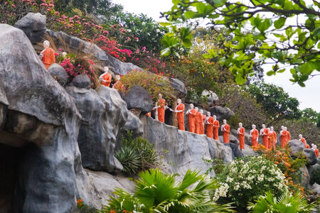 DAMBULLA, SRI LANKA - FEBRUARY 27, 2014: Buddhist monk statues at Golden Temple. It is is the largest, best-preserved cave-temple complex in Sri Lanka listed as UNESCO World Heritage site.