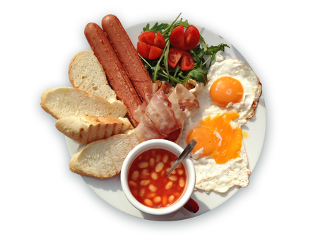 beans on toast: English breakfast with bacon, eggs, sausages, toast, tomatoes, salad and baked beans. Stock Photo