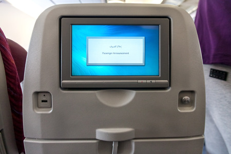 onboard: Economy class seat with entertainment system onboard.