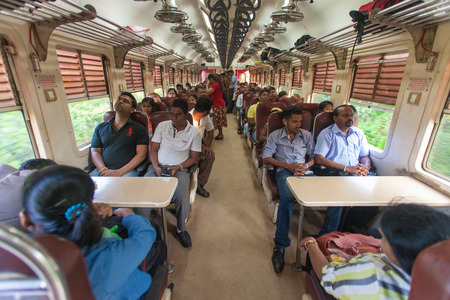 poorly: HIKKADUWA, SRI LANKA - FEBRUARY 22, 2014: Local commuters sit in train to Colombo. Trains are very cheap and poorly maintained but its the best option to witness a bit of everyday local life.