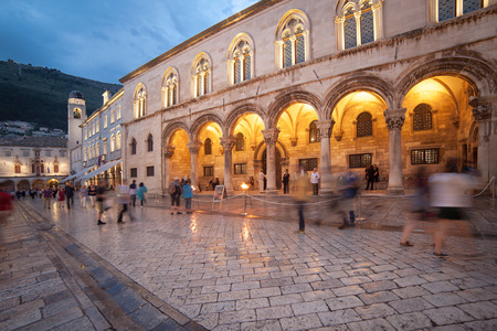 ragusa: DUBROVNIK, CROATIA - MAY 27, 2014: Night shot of tourists in front of Rectors palace. Palace used to serve as seat of the Rector of the Republic of Ragusa and today is the museum.