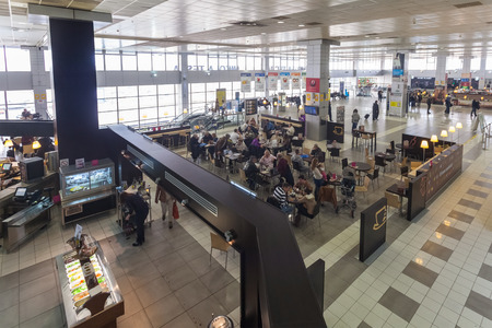 fastest: BELGRADE, SERBIA - FEBRUARY 18, 2014: Tourists having lunch in restaurant at Belgrade airport Nikola Tesla, the fastest growing major airport in Europe.