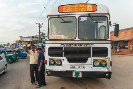 mode transport: GALLE, SRI LANKA - FEBRUARY 22, 2014: Large public transport bus stopped on street. Buses are the Sri Lankan principal mode of public transport.