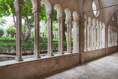 transitional: Hallway around famous courtyard in the Monastery of the Friars minor in Dubrovnik, Croatia. It is the most important work from the transitional period from the Romanesque to Gothic style