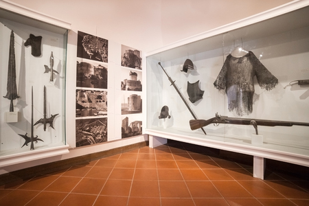 recreate: DUBROVNIK, CROATIA - MAY 27, 2014: Weapons exhibit in the Cultural Historical Museum inside the Rectors Palace. The majority of the halls have styled furniture to recreate the original atmosphere