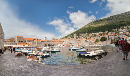 ragusa: DUBROVNIK, CROATIA - MAY 26, 2014: Small boats in city port with mount Srdj in background. Port is safe haven for many private boats of local citizens.